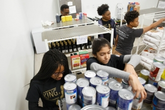 Members of the GW community stock the shelves of The Store in District House, which provides food to students in need