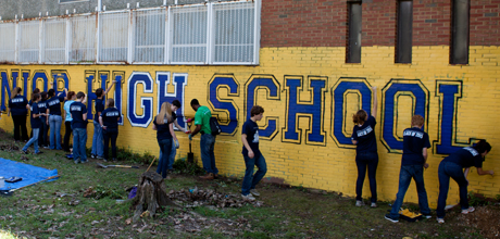 Students paint at Freshman Day of Service