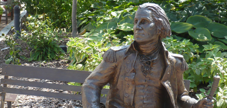 Bronze Statue of George Washington on a Bench