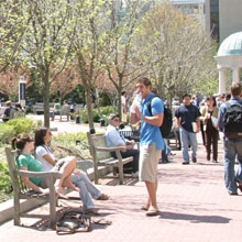 Students enjoy a sunny day on Kogan Plaza.