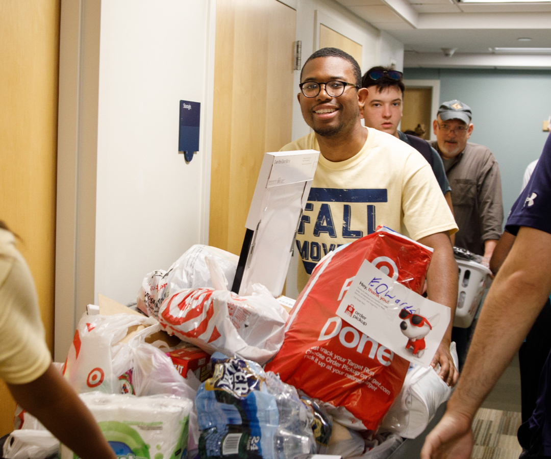 Students in a residence hall during move-in