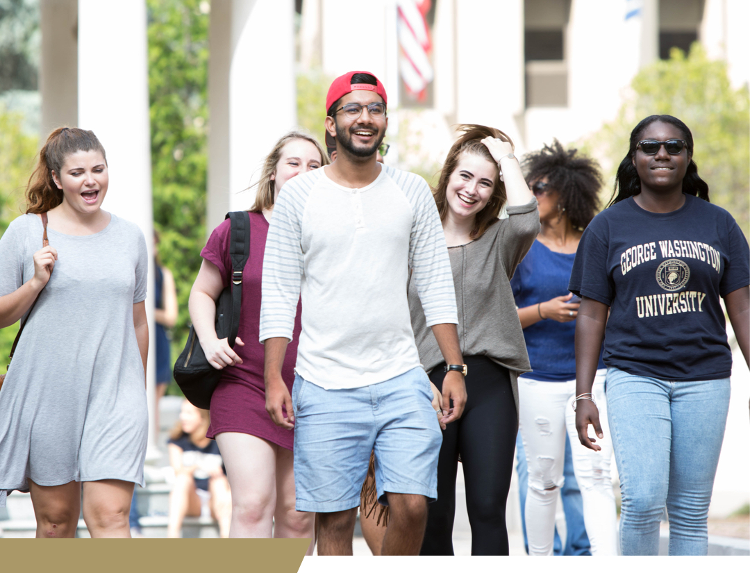 students walking on campus laughing